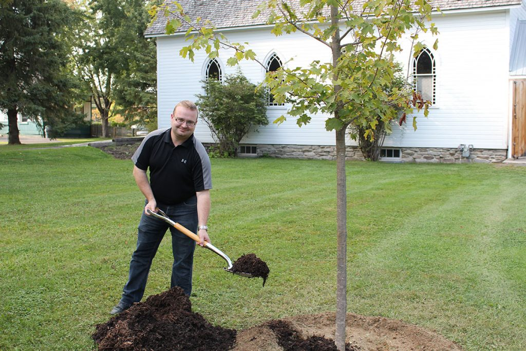 Stephen Blais planting a tree
